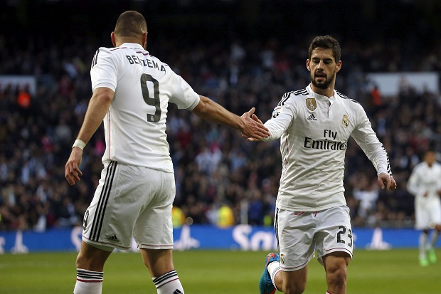 Real Madrid's Isco celebrates his goal against Deportivo Coruna with teammate Benzema during their Spanish first division soccer match at Santiago Bernabeu stadium in Madrid