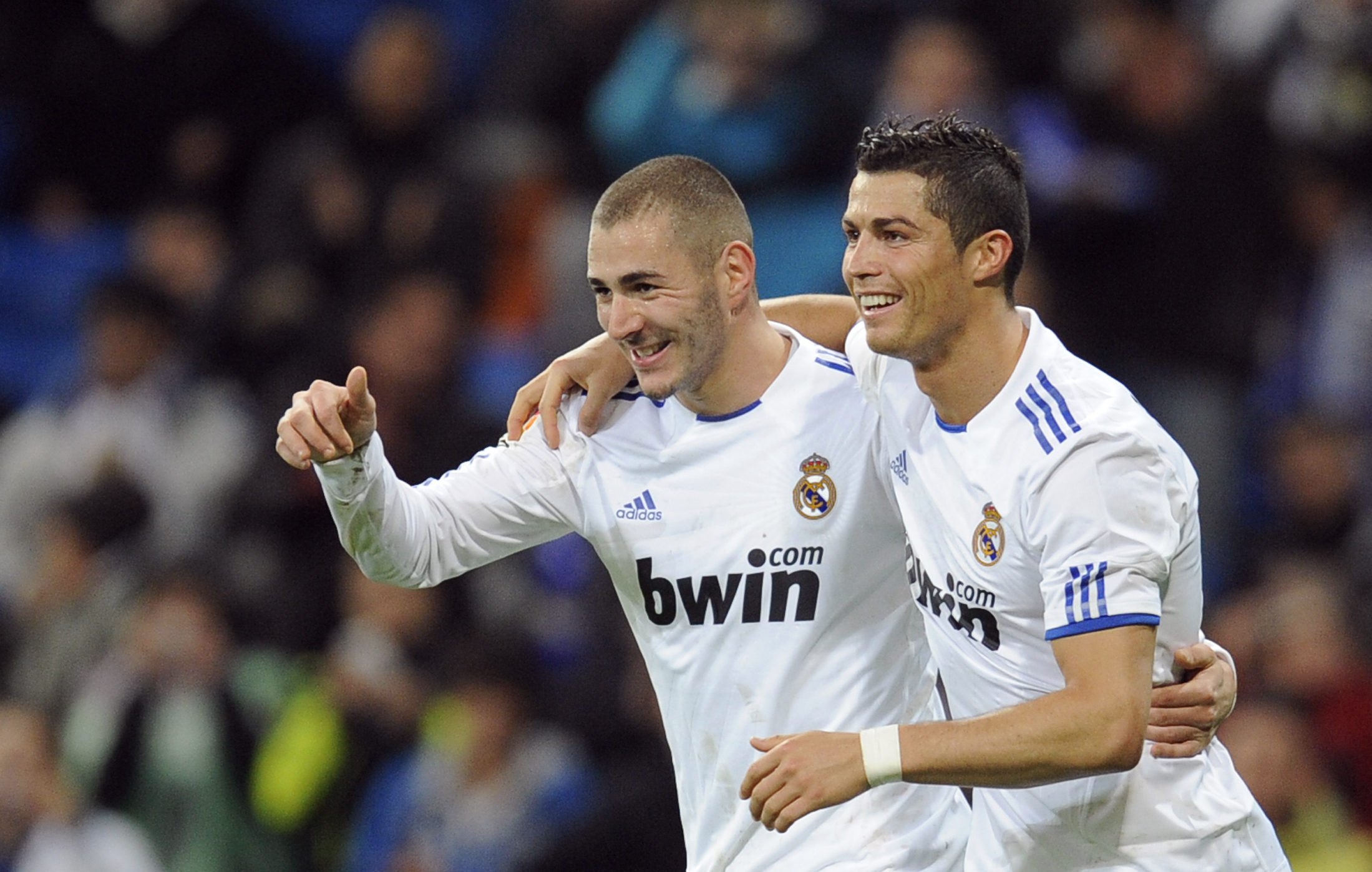 Real Madrid's Benzema celebrates his goal with teammate Ronaldo during their Spanish King's Cup soccer match at Santiago Bernabeu stadium in Madrid
